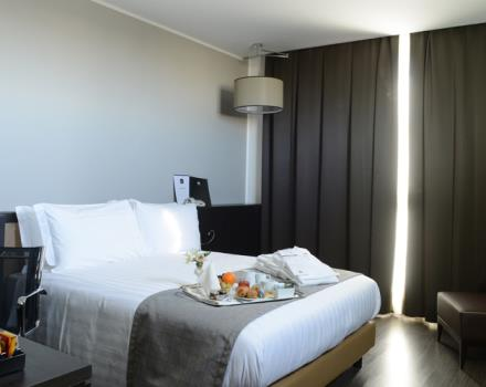 Discover the comfortable rooms at the Best Western Premier CHC Airport in Genoa